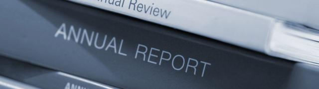 Close up of stacked annual reports